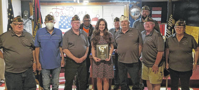 Teacher of the Year (grades K-5) Andrea Laux with members of VFW Post 6710.