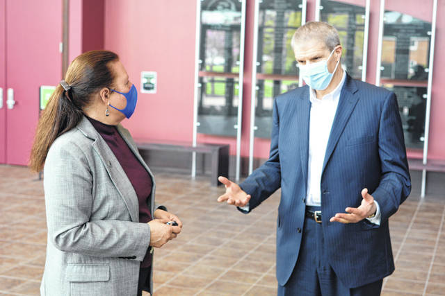 ATSG's Michael Berger chats with WC's Sylvia Stevens, vice president for external programs.