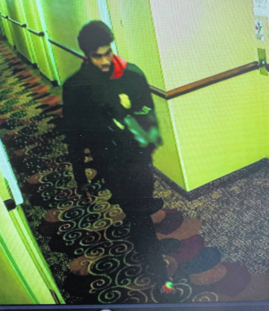 """The Warren County Sheriff's Office is asking for the public's help in identifying the man in the photo, who is a suspect in a theft which occurred at a local hotel. Credit cards, cash and a loaded firearm were stolen in the theft. The suspect possibly goes by the name """"Tay"""" or """"Donavan."""" Anyone with any information is urged to contact Detective Mike Wyatt with the Warren County Sheriff's Office at 513-701-1806."""