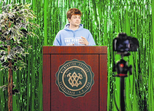 Sophomore Grant Mihalick pitches One Percent Basketball, his business featuring sports training for youth. Grant's attire features his business' brand visual identity.