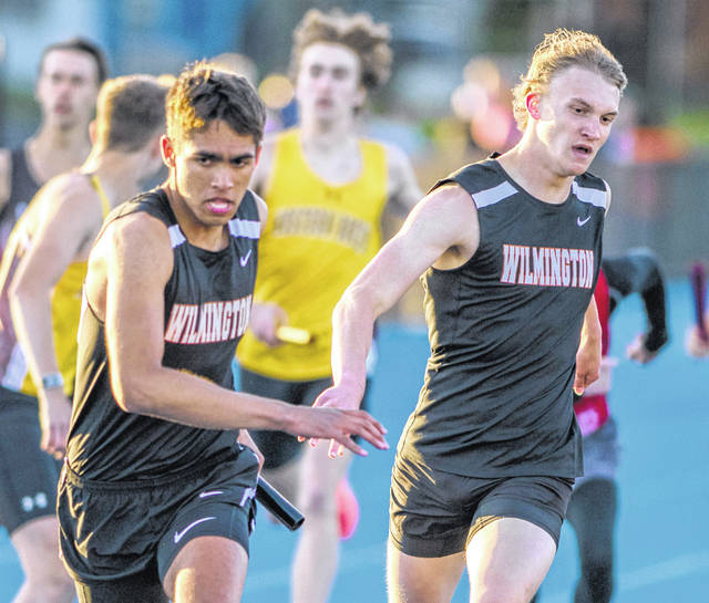 Wilmington's Ben Baylor (left) and Josh Andrews (right) were half of the regional qualifying 4x400-meter relay team. Shown here at the SBAAC Track and Field Championship, the two teams with TJ Killen and Blaize Johnson Friday to finish fourth in the final event of the Div. I Bellbrook District Track and Field Championship.