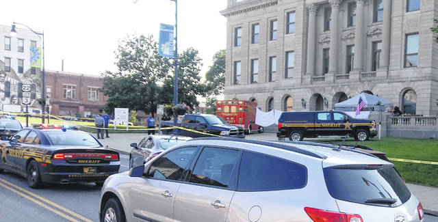 Clinton County Sheriff's vehicles block South South Street in front of the courthouse Tuesday morning while they investigate the incident and remove the body from the scene.