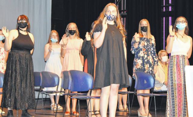 """""""I pledge myself to uphold the high standard of the National Junior Honor Society to which I have been selected …,"""" begins the NJHS pledge. Twenty-three eighth- and seventh-grade Wilmington Middle School students took the pledge Tuesday at the induction ceremony of the new Linda Floyd Chapter of the National Junior Honor Society."""
