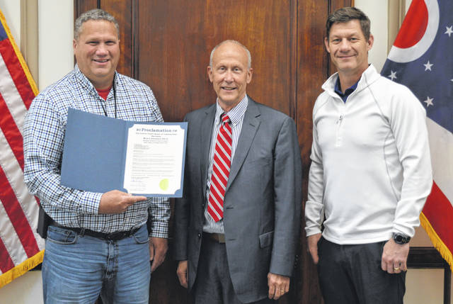 On Wednesday the Clinton County Board of Commissioners recognized Monte R. Anderson, long-time Wilmington College Professor of Agriculture, for being chosen a 2021 Ohio Agricultural Hall of Fame inductee. From left are Clinton County Commissioner Mike McCarty, Monte Anderson, and Clinton County Commissioner Kerry Steed.
