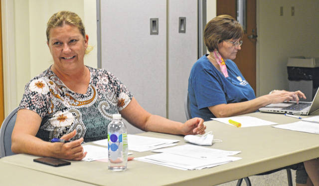 From left at Monday's meeting of the Clinton County Board of Health are Clinton County Health Commissioner Pam Bauer and Tansy Bernard with the health department.