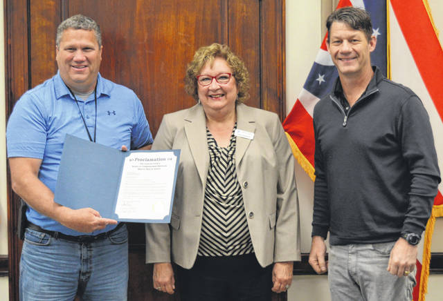 """Clinton County commissioners on Monday proclaimed May 2021 as Mental Health Month in the county. Noting the pandemic, the proclamation states, """"There are practical tools that all people can use to improve their mental health and increase resiliency, and with effective treatment, those individuals with mental health conditions can recover and lead full, productive lives."""" From left are Clinton County Commissioner Mike McCarty, Mental Health Recovery Board Executive Director Colleen Chamberlain, and Clinton County Commissioner Kerry Steed."""
