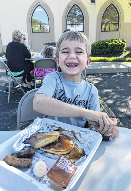 Knox Shidaker is ready to enjoy a pancakes-and-sausages meal outdoors on a sunny spring Saturday at the Clinton County Board of Realtors annual Day of Caring Pancake Brunch fundraiser. He was there with his family.
