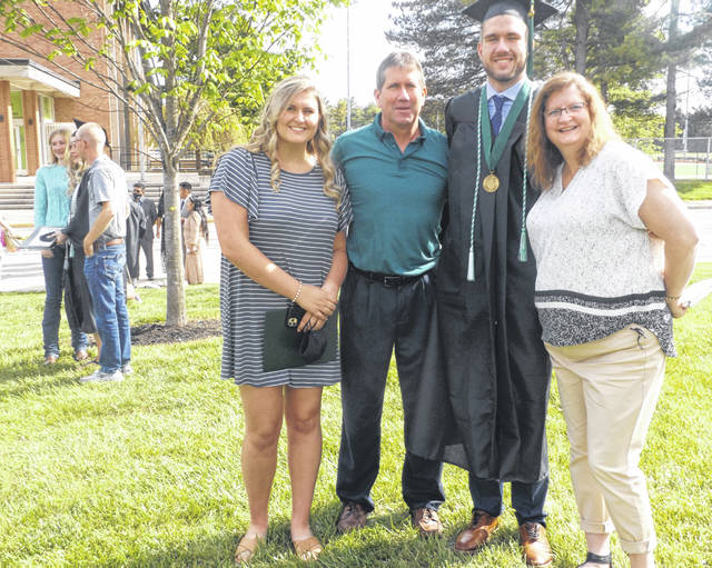 Tyler Wells of Wilmington graduated Saturday from Wilmington College, with a Business Administration major in which he had a concentration in Marketing, accompanied by a minor in Communications. Following the Bachelor of Arts commencement ceremony in the afternoon, he posed on Collett Mall with family. From left in the foreground are sister Jess, father Bill, Tyler, and mother Tina.