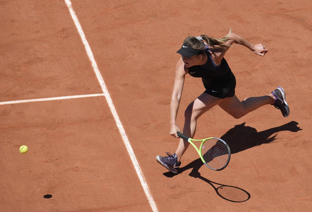 Ukraine's Elina Svitolina plays a return to Oceane Babel of France during their first round match on day three of the French Open tennis tournament at Roland Garros in Paris, France, Tuesday, June 1, 2021. (AP Photo/Christophe Ena)