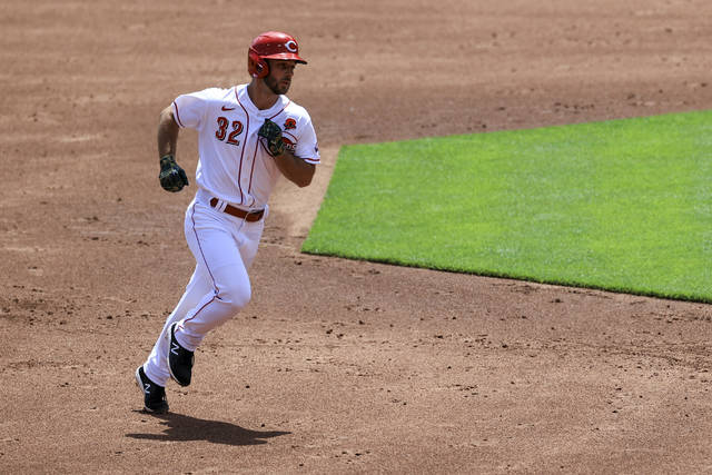 Cincinnati Reds' Max Schrock runs the bases after hitting a two-run home run during the second inning of a baseball game against the Philadelphia Phillies in Cincinnati, Monday, May 31, 2021. (AP Photo/Aaron Doster)