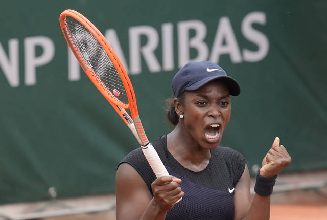 United States's Sloane Stephens celebrates after defeating Czech Republic's Karolina Muchova during their third round match on day 7, of the French Open tennis tournament at Roland Garros in Paris, France, Saturday, June 5, 2021. (AP Photo/Christophe Ena)