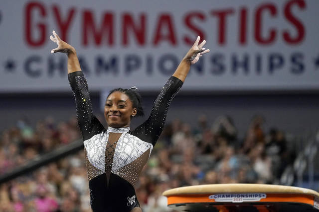 Simone Biles celebrates after competing in the vault during the U.S. Gymnastics Championships, Sunday, June 6, 2021, in Fort Worth, Texas. (AP Photo/Tony Gutierrez)