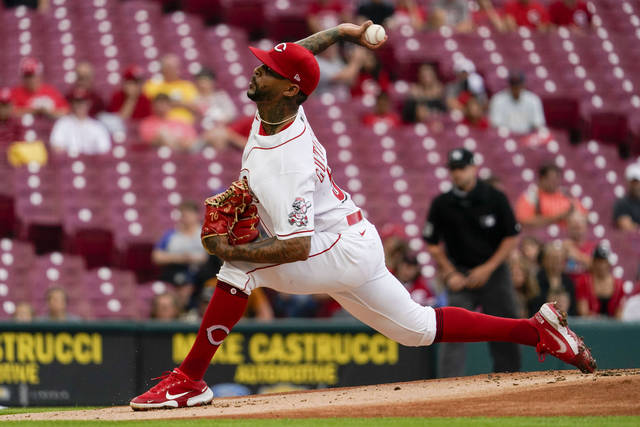 Reds starting pitcher Vladimir Gutierrez throws during the first inning of the team's baseball game against the Milwaukee Brewers in Cincinnati on Wednesday, June 9, 2021. (AP Photo/Jeff Dean)