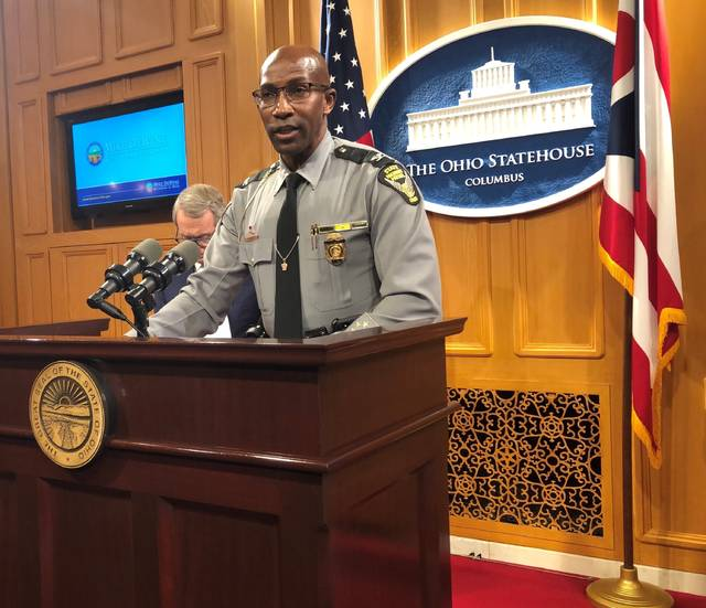 Colonel Richard Fanbro, Superintendent of the Ohio State Highway Patrol, discusses patrol efforts to reduce distracted driving accidents during the holidays, at a news conference promoting safe holiday driving and also attended by Ohio Gov. Mike DeWine, on Friday, Dec. 20, 2019, in Columbus, Ohio. Fanbro said distracted driving is unsafe and irresponsible and can have devastating results for families of people injured or killed in distracted driving accidents. (AP Photo/Andrew Welsh-Huggins)