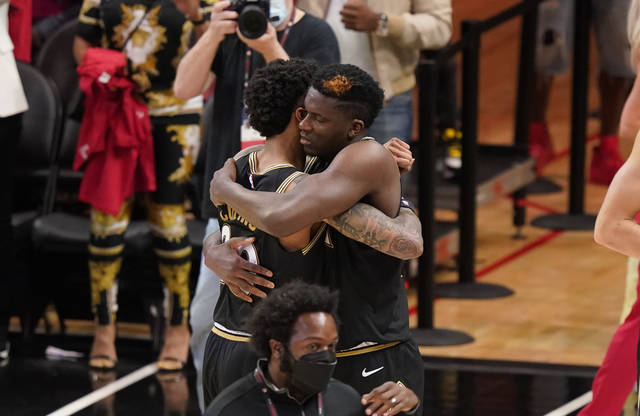 Atlanta Hawks' John Collins, left, hugs teammate Clint Capela, right, after Game 4 of a second-round NBA basketball playoff series against the Philadelphia 76ers, Monday, June 14, 2021, in Atlanta. (AP Photo/Brynn Anderson)
