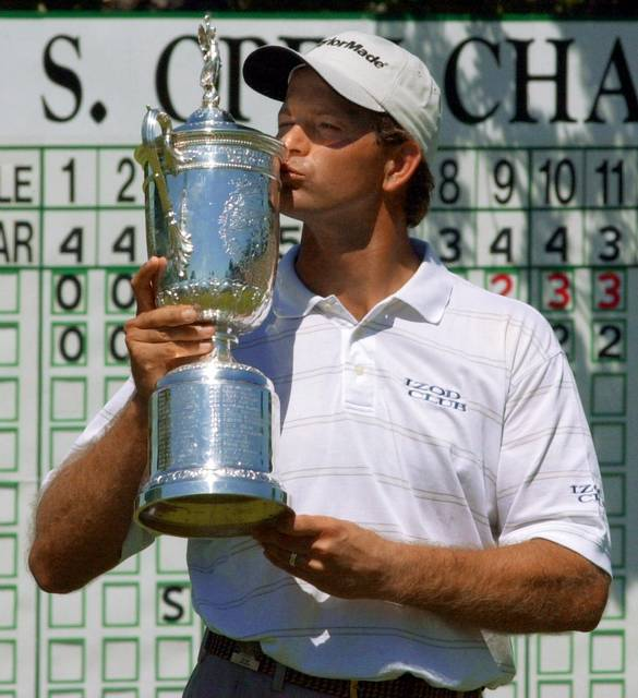 FILE - In this June 18, 2001, file photo, Retief Goosen, of South Africa, kisses the winner's trophy on the 18th green at Southern Hills Country Club after beating Mark Brooks in a 18-hole playoff for the U.S. Open Championship in Tulsa, Okla. Twenty years ago this week, Goosen missed a 2-foot putt and was forced into a playoff. (AP Photo/Dave Martin, File)