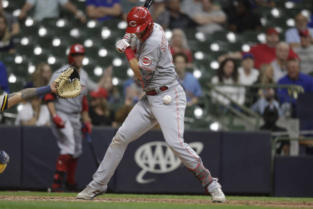 Cincinnati Reds' Tyler Stephenson is hit by a pitch during the 10th inning of the team's baseball game against the Milwaukee Brewers on Tuesday, June 15, 2021, in Milwaukee. (AP Photo/Jeffrey Phelps)