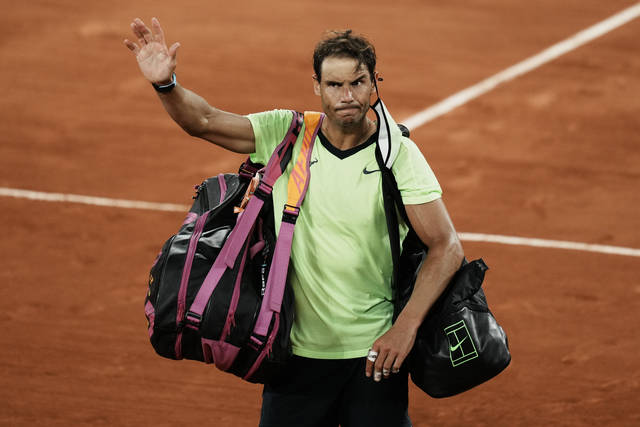 Spain's Rafael Nadal waves to the crowd after losing to Serbia's Novak Djokovic in their semifinal match of the French Open tennis tournament at the Roland Garros stadium Friday, June 11, 2021 in Paris. Djokovic won 3-6, 6-3, 7-6 (4), 6-2. (AP Photo/Thibault Camus)