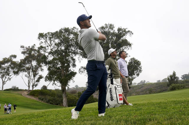 Brooks Koepka hits from the rough on the 13th fairway during a practice round of the U.S. Open Golf Championship, Wednesday, June 16, 2021, at Torrey Pines Golf Course in San Diego. (AP Photo/Marcio Jose Sanchez)