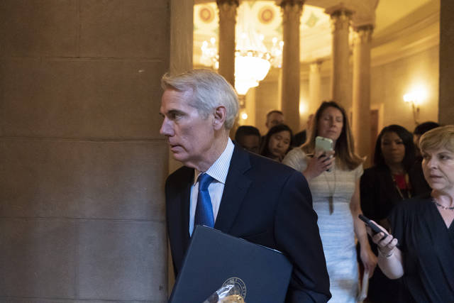 Sen. Rob Portman, R-Ohio, arrives for a meeting at the Capitol in Washington, Wednesday, June 23, 2021. Congressional negotiators and the White House appear open to striking a roughly $1 trillion deal on infrastructure, but they are struggling with the hard part — deciding who will pay for it.(AP Photo/Alex Brandon)