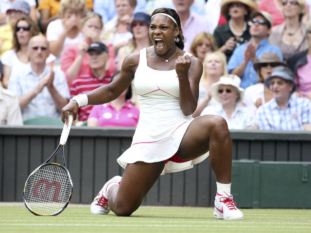 FILE - In this July 3, 2010, file photo, Serena Williams celebrates a point win over Russia's Vera Zvonareva during their women's singles final at the All England Lawn Tennis Championships at Wimbledon. How much do you know about Wimbledon?  (AP Photo/Alastair Grant, File)