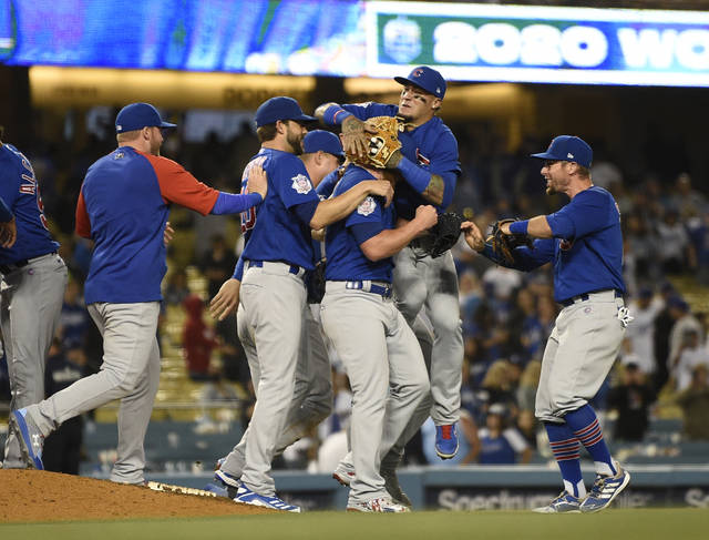The Chicago Cubs celebrate a combined no-hitter after the final out by relief pitcher Craig Kimbrel in a baseball game against the Los Angeles Dodgers in Los Angeles, Thursday, June 24, 2021. The Cubs won 4-0. (AP Photo/Kelvin Kuo)