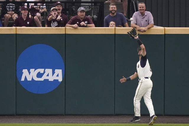 Mississippi State fans react as Notre Dame infielder Spencer Myers (2) catches a Mississippi State fly ball in the first inning of an NCAA college baseball super regional game, Sunday, June 13, 2021, in Starkville, Miss. Notre Dame won 9-1. (AP Photo/Rogelio V. Solis)