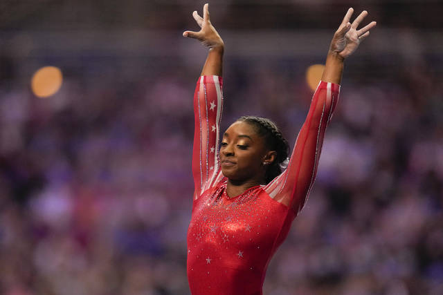 Simone Biles lands after competing on the vault during the women's U.S. Olympic Gymnastics Trials Sunday, June 27, 2021, in St. Louis. (AP Photo/Jeff Roberson)