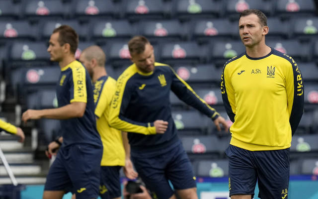 Ukraine's manager Andriy Shevchenko watches his players during a training session at the Hampden Park Stadium in Glasgow, Monday, June 28, 2021, the day before their round of 16 Euro 2020 match against Sweden. (AP Photo/Petr David Josek)