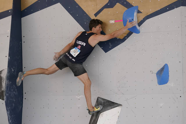FILE - Nathaniel Coleman climbs during the men's boulder qualification at the climbing World Cup in Salt Lake City, in this Friday, May 21, 2021, file photo. Climbing is an Olympic sport for the first time, and the spotlight will introduce a massive audience to what can be a lonely pursuit. (AP Photo/Rick Bowmer, File)