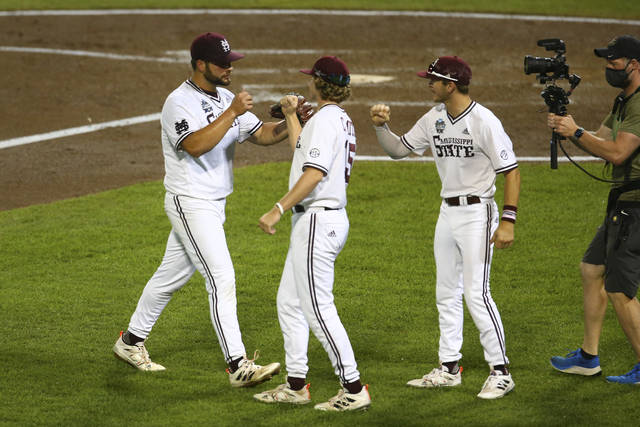 Mississippi State pitcher Preston Johnson, left, celebrates with teammates during the sixth inning against Vanderbilt in Game 2 of the NCAA College World Series baseball finals, Tuesday, June 29, 2021, in Omaha, Neb. (AP Photo/John Peterson)