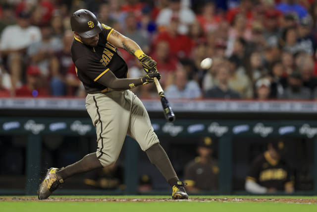 San Diego Padres' Tommy Pham hits a solo home run during the fourth inning of a baseball game against the Cincinnati Reds in Cincinnati, Tuesday, June 29, 2021. (AP Photo/Aaron Doster)