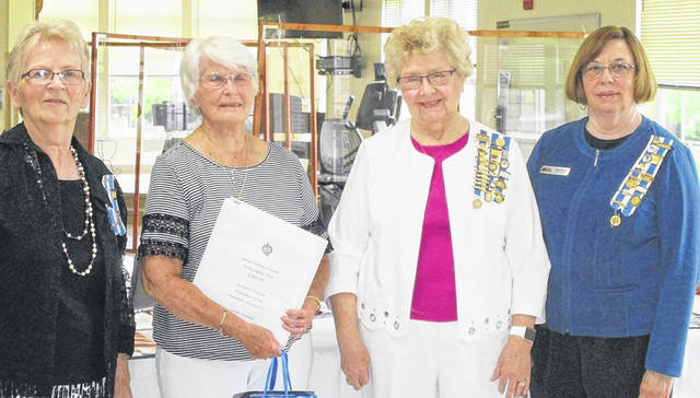 Barbara Scarboro, Frances Sharp and Susan Henry welcome new member Linda Conover.