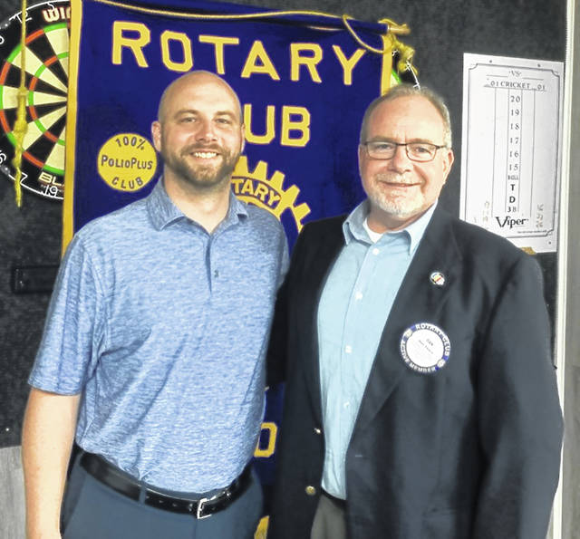Guest Justin Dunn, left, with Dan Evers, President of the Wilmington Rotary Club.