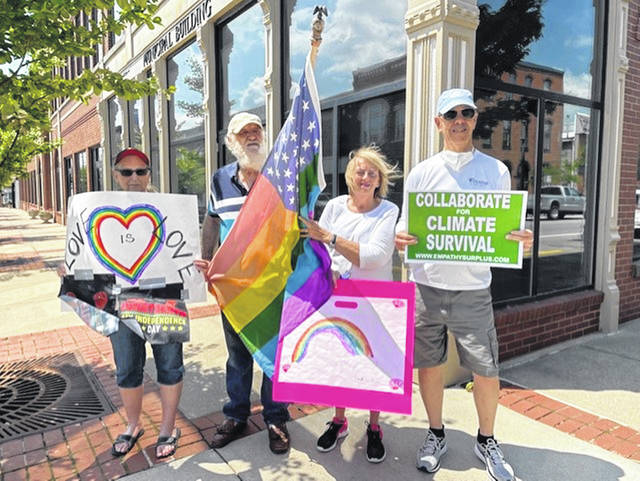 Members and friends of the Clinton County Alliance for Compassion and Truth (A.C.T.) recognized June Pride Month 2021 at a stand-out in Wilmington on Saturday. Among the participants were, from left, A.CT. President Elaine Silverstrim, Lee Silverstrim, Beth Gilkison, and Chuck Watts. Clinton County A.CT. is a women-led organization dedicated to promoting democracy and equality through advocacy and education.
