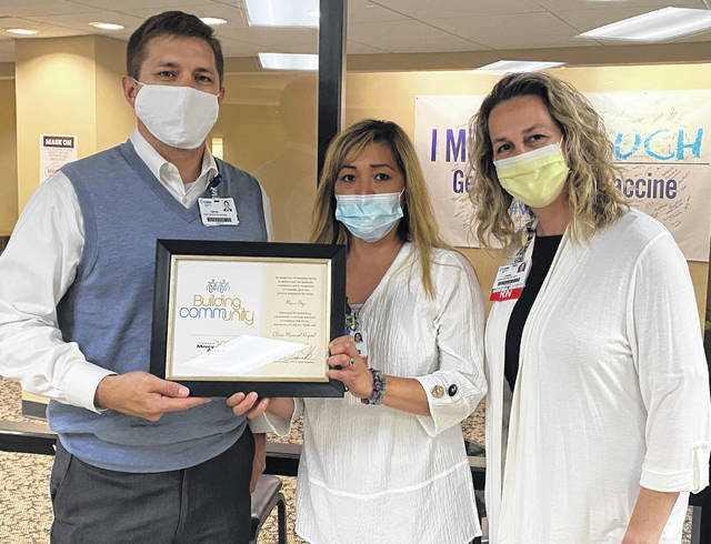 From left are Lance Beus, CEO; Marco Otey, RN; and Lesley Wininger, CNO.