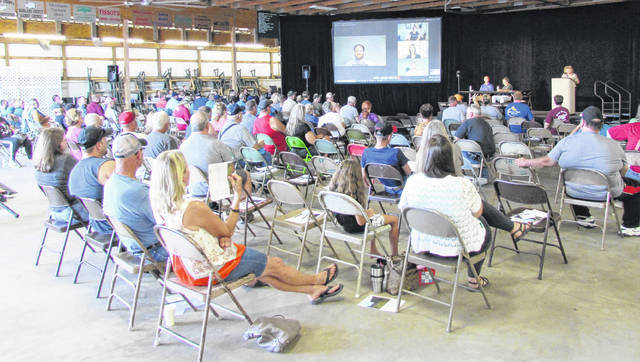 Despite temperatures that flirted with 100 degrees in the Rabbit & Poultry Building on the Highland County Fairgrounds, between 75-100 people showed up Monday to give public input on the proposed Palomino Solar Farm project.