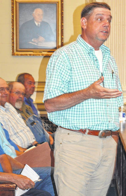 Kirk McMillan from the New Vienna area participates in the public forum.