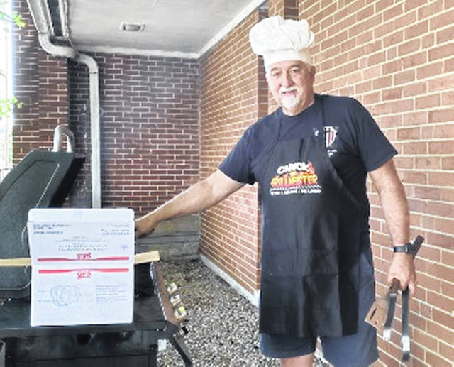 """Pastor Chuck Shonkwiler of Grace United Methodist Church in Blanchester is retiring as pastor effective June 20. Also known for presiding over the grill during the church's monthly Thursday free community dinners for most of his 11 years as pastor, the ladies gave him the apron, and the parents of the UMC custodian gave him the chef's hat. """"He will be greatly missed,"""" said Patty Williams."""