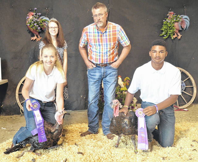 For Market Turkey, Bronze Tom: Shown from left are: front, Champion Lexus Rieley and Reserve Champion John Michael Streety; and, back, Poultry Queen Alyssa Hutchinson and Judge Mark Lange.