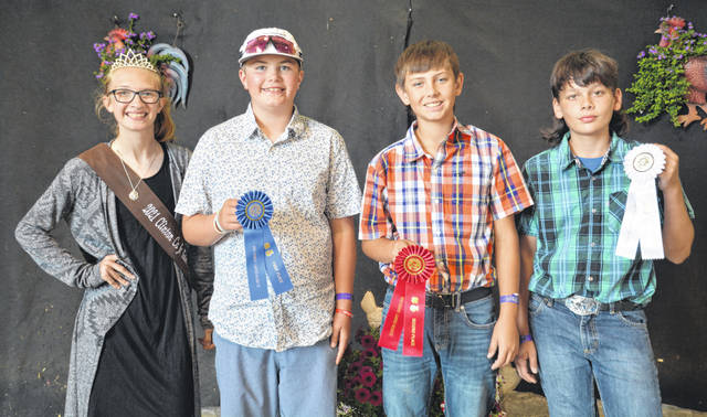 For Hay Mixes at the 2021 fair: From left are FCS Queen Mikala Hatfield, first place Wade Smith, second Shane Louderback, and third Elliot Pell.