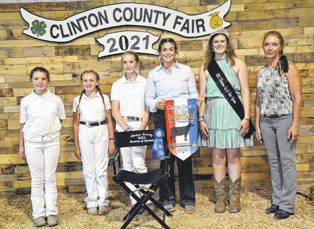 Winners in Dairy Showmanship at the 2021 Clinton County Fair include: Beginner Showmanship, Emma Meyers; Junior Showmanship, Ally Montague; Intermediate Showmanship, Shelby Leaming; Senior Showmanship, Maggie Matthews; with Queen Shaleigh Duncan and Judge Sherry B. Smith.