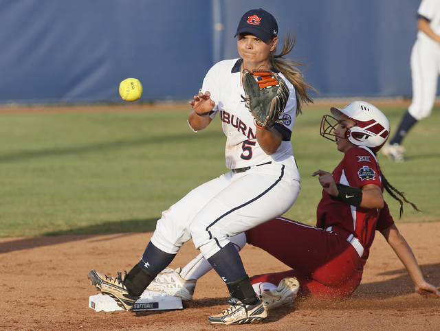 FILE - Auburn's Emily Carosone (5) waits for the late throw as Oklahoma's Raegan Rogers advances to second base on a ball hit by Kelsey Arnold during the second inning of the second game of the best-of-three championship series in the NCAA Women's College World Series in Oklahoma City, in this Tuesday, June 7, 2016, file photo. Italy's roster for the Tokyo Games includes second baseman Emily Carosone, born in Orlando, Florida. (AP Photo/Sue Ogrocki, File)