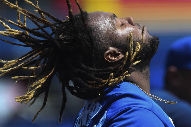 Toronto Blue Jays' Vladimir Guerrero Jr. throws his head back before putting on his batting helmet during the fifth inning of a baseball game against the Baltimore Orioles in Buffalo, N.Y., Sunday, June 27, 2021. (AP Photo/Joshua Bessex)