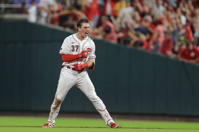 Cincinnati Reds' Tyler Stephenson yells after driving in the winning run with a single during the ninth inning of the team's baseball game against the San Diego Padres in Cincinnati, Thursday, July 1, 2021. The Reds won 5-4. (AP Photo/Aaron Doster)