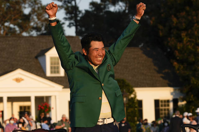 FILE - In this April 11, 2021, file photo, Hideki Matsuyama, of Japan, celebrates during champion's green jacket ceremony after winning the Masters golf tournament in Augusta, Ga. Matsuyama is among the favorites to win a gold medal in golf at the Olympics, all because of his green jacket. Matsuyama became the first Japanese player to win the Masters, a source of pride for a country with the greatest golf heritage of all Asian nations. (AP Photo/David J. Phillip, File)