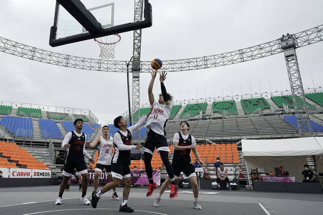 FILE - In this May 16, 2021, file photo, athletes compete during the Tokyo 2020 Olympic Game men's basketball 3x3 test event at Aomi Urban Sports Park in Tokyo. The latest stop on the perennial search for a younger, more attention-span-challenged audience for the Olympics might look familiar — the blacktop, and 3-on-3 basketball. (AP Photo/Eugene Hoshiko, File)