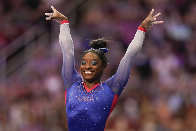 Simone Biles celebrate her performance on the vault during the women's U.S. Olympic Gymnastics Trials Friday, June 25, 2021, in St. Louis. (AP Photo/Jeff Roberson)