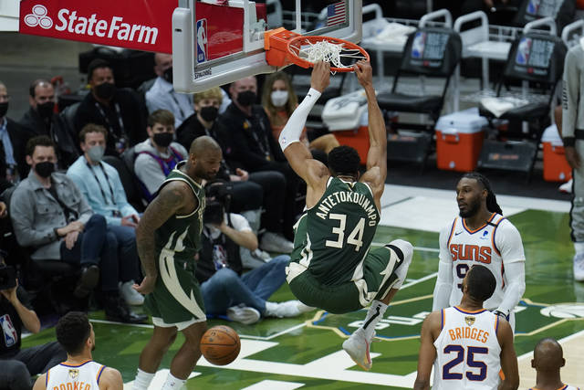 Milwaukee Bucks' Giannis Antetokounmpo (34) dunks during the first half of Game 3 of basketball's NBA Finals against the Phoenix Suns in Milwaukee, Sunday, July 11, 2021. (AP Photo/Paul Sancya)