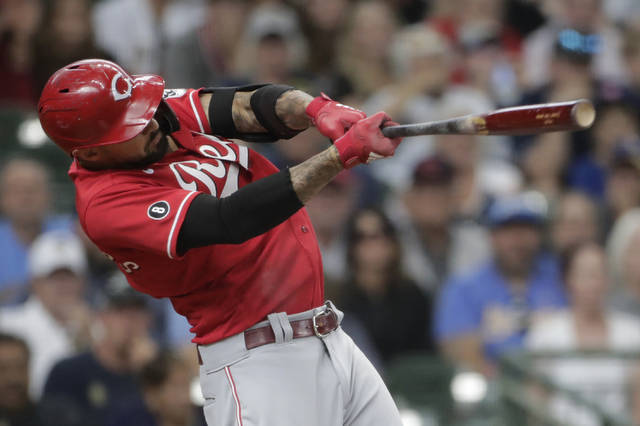 Cincinnati Reds' Nick Castellanos hits a two-run single during the ninth inning of a baseball game against the Milwaukee Brewers Sunday, July 11, 2021, in Milwaukee. (AP Photo/Aaron Gash)